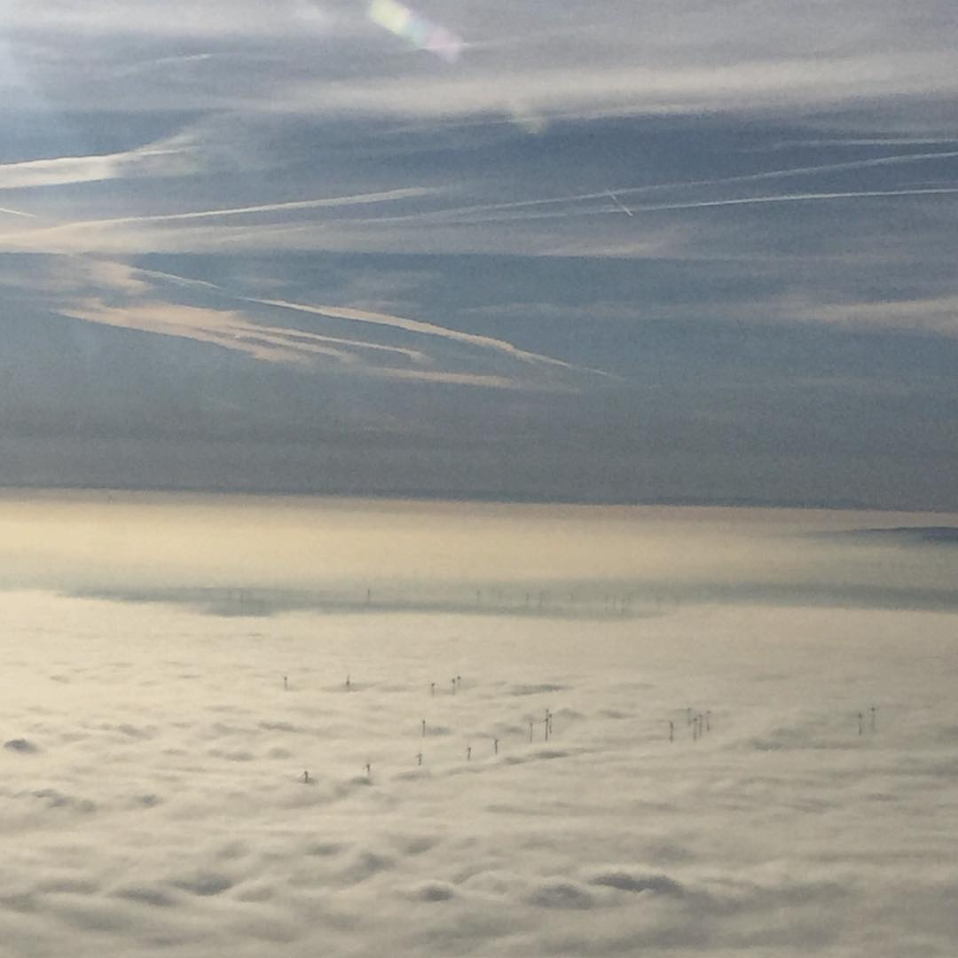 Wind turbines poke through the clouds near Frankfurt